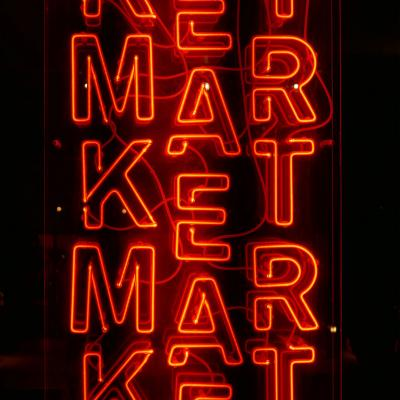 Red neon market sign