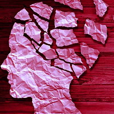 Silhouette profile of a woman's face made from scraps of torn paper