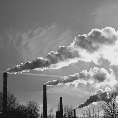 Industrial smokestacks releasing pollution into the sky