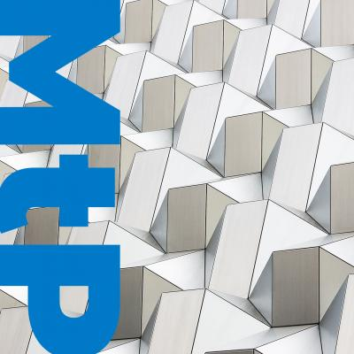Detail of white and grey geometric architectural panels with letter MTP overlaid